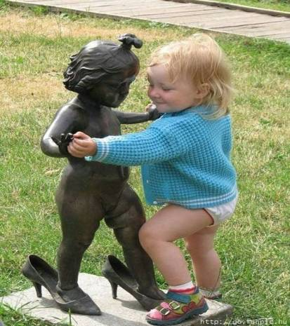 statue and baby dancing
