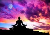 11534351-yoga-meditation-in-lotus-pose-by-man-silhouette-with-moon-and-purple-dramatic-sunset-sky-background-